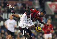 Photo: Paul Thomas.<br />Manchester United v Liverpool. The Barclays Premiership. 22/01/2006.<br /><br />Liverpool's Djibril Cisse is tackled by Patrice Erva