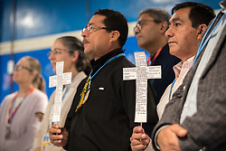 13 December 2019, Madrid, Spain: Latin American church leaders Rev. Nehemias Rivera Medina of the Lutheran Costa Rican Church (right) and Rev. Santiago de Jesús Rodríguez Lara from the Salvadoran Lutheran Church (left) hold crosses, as faith-based organizations gather for a vigil, as COP25 is about to draw to a close, praying that negotiations will bear fruit, bringing about urgent and just action to find a way out of the climate crisis. The crosses are replicas of a much larger cross from the Lutheran Cathedral of El Salvador, referred to as 'La Cruz Subversiva'. On the cross are written testimonies of people in El Salvador noting down the oppressions they suffer in their daily lives. The cross has a special history, in that it was confiscated by 'El Ejército' (The People's Revolutionary Army) in November 1989, while El Salvador was living through war.