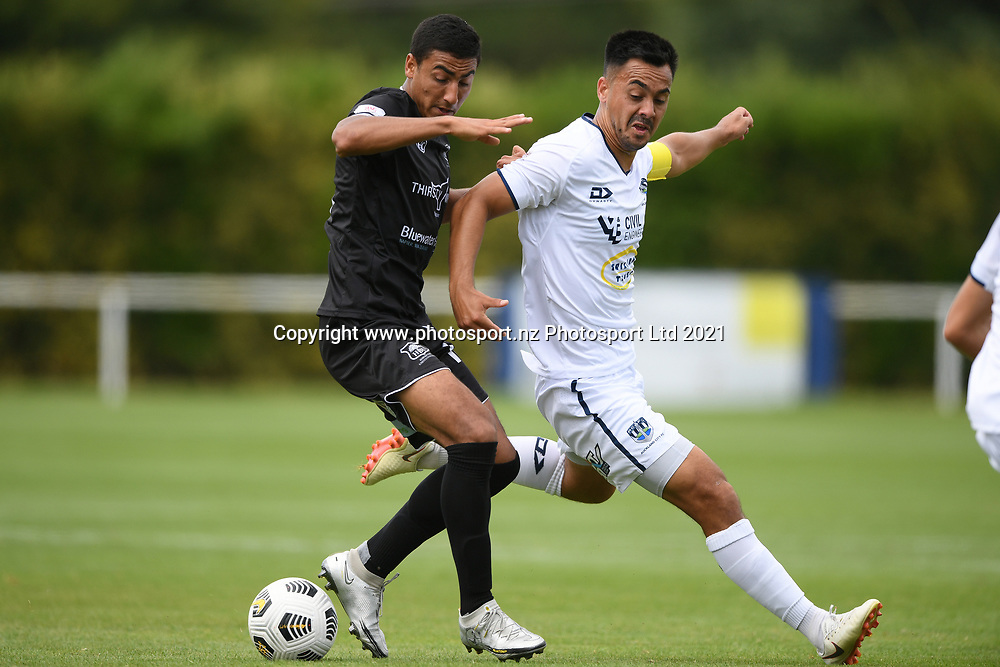 Hawke's Bay United's Kaeden Atkins and Auckland City FC's Cam Howieson scramble for the ball in the Handa Premiership football match, Hawke's Bay United v Auckland City FC, Bluewater Stadium, Napier, Sunday, January 31, 2021. Copyright photo: Kerry Marshall / www.photosport.nz