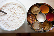Indian lunch raita with chickpeas and a tray of spices in the kitchen of the  Qureshi family of Lorenskog, Norway, an Oslo suburb.