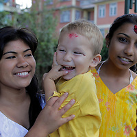 Asia, Nepal, Kathmandu. Nepali sisters and baby brother.