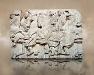 Marble Releif Sculptures from the north frieze around the Parthenon Block XLIII 118-120. From the Parthenon of the Acropolis Athens. A British Museum Exhibit known as The Elgin Marbles .<br /> <br /> If you prefer to buy from our ALAMY STOCK LIBRARY page at https://www.alamy.com/portfolio/paul-williams-funkystock/greco-roman-sculptures.html . Type -    Elgin    - into LOWER SEARCH WITHIN GALLERY box - Refine search by adding a subject, place, background colour, etc.<br /> <br /> Visit our ROMAN WORLD PHOTO COLLECTIONS for more photos to download or buy as wall art prints https://funkystock.photoshelter.com/gallery-collection/The-Romans-Art-Artefacts-Antiquities-Historic-Sites-Pictures-Images/C0000r2uLJJo9_s0
