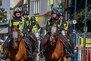 Horseback Police are deployed to patrol Market Square via Cannon Street in Dover, Kent ahead of warnings announced for a rival far-right and pro-migrant groups preparing to descend on the coastal town on Saturday, Sept 5, 2020. fears of violence against the refugees announced by far-right groups who are expected to assemble to demonstrate over migrant crossings. Pro-migrant protesters are already gathered in the town on Saturday amid a heavy police presence. Dover MP Natalie Elphicke has urged people to stay away from the protests given the backdrop of the Covid-19 pandemic. British media reports say that on Friday, an activist group projected pro-immigrant messages onto the White Cliffs of Dover ahead of the protests saying 'Rise above fear. Refugees welcome' (VXP Photo/ Vudi Xhymshiti)