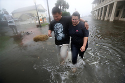 October 7, 2016 - Mcdonough, Georgia, U.S. - Local residents MICHAEL and TORI MUNTON make their way through the flooded streets of downtown historic Saint Marys as the storm surge from Hurricane Matthew hits on Friday. Fire and Police units have been pulled back until the winds die down. (Credit Image: © Curtis Compton/TNS via ZUMA Wire)