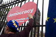 A remain campaigner holds a sign reading We Love Democracy outside the Houses of Parliament on 9th September 2019 in London, United Kingdom. Prime Minister Boris Johnson is tabling another motion to seek a general election.