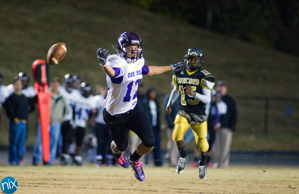 Cox Mill's Kenney Parker reaches out for an overthrown pass against Concord during the first round of the NCHSAA 3A playoffs Friday night at Concord High School. Concord won the game 30-12 to advance. (Photo by James Nix)