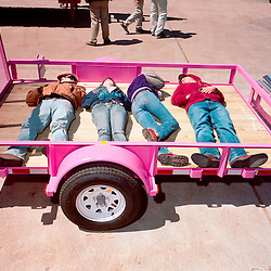 Houston, Texas - March 2010- Exhausted at the end of the Houston Rodeo, students from Rennard, Texas lie exhausted on a pink trailerr.  They are from left to right, Nolan Hyatt, 17, Courtney Cole, 17, Amber Rushing, 17 and John Lenderman, 17.  Photo by Susana Raab