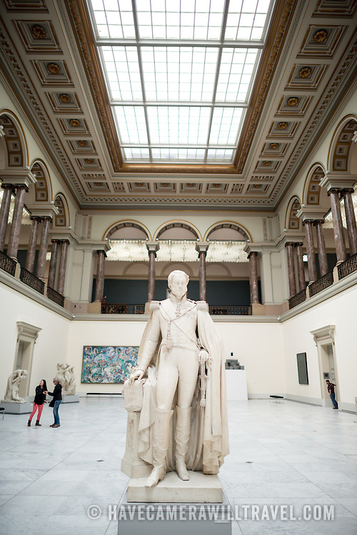 A statue of King Leopold I dated to around 1853 by Guillaume Geefs on display in the main hall at the Royal Museums of Fine Arts in Belgium (in French, Musées royaux des Beaux-Arts de Belgique), one of the most famous museums in Belgium. The complex consists of several museums, including Ancient Art Museum (XV - XVII century), the Modern Art Museum (XIX  XX century), the Wiertz Museum, the Meunier Museum and the Museé Magritte Museum.