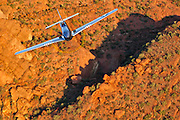"""Spectacular color photographic image of a P-51 Mustang """"Cripes A' Mighty"""" taken air to air over the Arizona desert"""