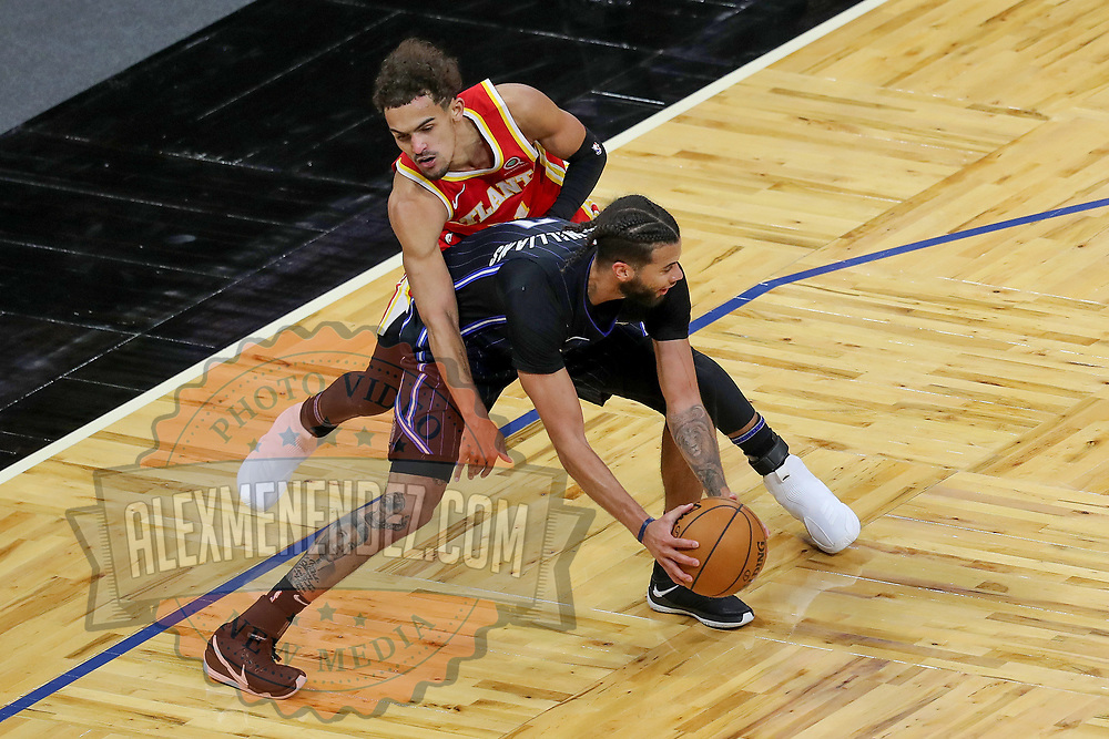 ORLANDO, FL - MARCH 03: Trae Young #11 of the Atlanta Hawks fouls Michael Carter-Williams #7 of the Orlando Magic at Amway Center on March 3, 2021 in Orlando, Florida. NOTE TO USER: User expressly acknowledges and agrees that, by downloading and or using this photograph, User is consenting to the terms and conditions of the Getty Images License Agreement. (Photo by Alex Menendez/Getty Images)*** Local Caption *** Trae Young; Michael Carter-Williams
