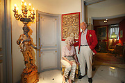 Wolf C Hartwig aged 91, producer of epic films and soft-porn features, with his fourth wife, and actress, Veronique Vendell in their apartment on Avenue de Foch, Paris. Wolf Hartwig was awarded a Bambi Award from German Cinema for his film 'The Iron Cross' which was directed by Sam Peckinpah starring James Coburn with Veronique Vendell. A producer working in exploitation genres, soft porn, sex, lurid, violent and sensational features. Other films he produced include 'Horrors from Spider Island'. 'Lady Hamilton' and 'Virgin of the Seven Seas'.//Wolf Hartwig and his wife Veronique Vendell in anti-chamber with Chinese intricate carved relief and sculpture