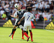 Gareth Bale of Wales © is challenged by Raheem Sterling of England.  Euro 2016, group B , England v Wales at Stade Bollaert -Delelis  in Lens, France on Thursday 16th June 2016, pic by  Andrew Orchard, Andrew Orchard sports photography.