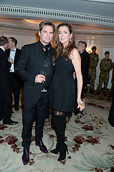 DANIEL GALVIN jnr and his wife SUZANNA at Fashion For The Brave at The Dorchester, Park Lane, London on 8th November 2013.