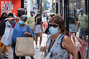As Britain enters a period of deep recession, with some shops closing either temporarily or permanently as the economic downturn caused by the Covid-19 pandemic cuts hard, shoppers wearing face masks continue to come to the West End to Oxford Street on 13th August 2020 in London, United Kingdom. Here, several shoppers are at a busy bus stop. The Office for National Statistics / ONS has announced that gross domestic product / GDP, the widest gauge of economic health, fell by 20.4% in the second quarter of the year, compared with the previous quarter. This is the biggest decline since records began. The result is that Britain has officially entered recession, as the UK economy shrank more than any other major economy during the coronavirus outbreak.