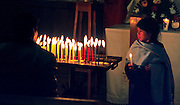 FEB 24, 2001 - SAN CRISTOBAL DE LAS CASAS, CHIAPAS, MEXICO: A Mayan Indian girl lights prayer candles in Santo Domingo Church in San Cristobal de las Casas, Chiapas, Mexico.  Photo By Jack Kurtz  CULTURE   RELIGION   FAMILY  WOMEN  CHILDREN