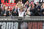 Forest Green Rovers manager, Mark Cooper lifts the trophy during the Vanarama National League Play Off Final match between Tranmere Rovers and Forest Green Rovers at Wembley Stadium, London, England on 14 May 2017. Photo by Shane Healey.
