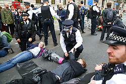 © Licensed to London News Pictures. 07/10/2019. London, UK. Police officers attends environmental and climate change activists from the Extinction Rebellion group as they chained and glued themselves on Whitehall  in Westminster, calling for the UK Government to take responsibility and enact immediate, profound and sweeping changes to address the crisis on climate and ecological changes. Photo credit: Dinendra Haria/LNP