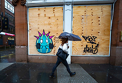 Glasgow, Scotland, UK. 1 November 2020. The Scottish Government today announced that from Friday 20 November, the most severe level 4 lockdown will be introduced in eleven Scottish council areas. This means non essential shops will close and bars, restaurants and cafes. Pictured;  Boarded up restaurant with Coronavirus graffiti.  Iain Masterton/Alamy Live News