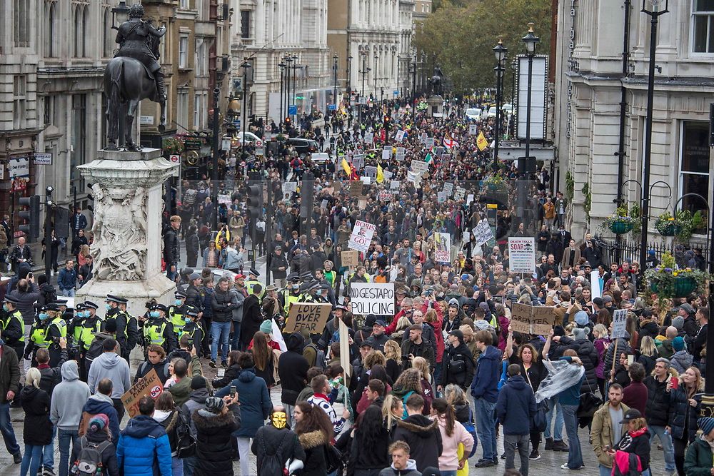© Licensed to London News Pictures. 24/10/2020. London, UK. Anti-mask and lockdown protestors gather in Whitehall during a United for Freedom demonstration in central London. Photo credit: Marcin Nowak/LNP