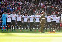 Football - 2016 / 2017 Premier League - Arsenal vs. Tottenham Hotspur<br /> <br /> Tottenham players observe the minutes silence at The Emirates.<br /> <br /> COLORSPORT/ANDREW COWIE
