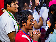 29 NOVEMBER 2017 - YANGON, MYANMAR:  People pray during the Papal Mass in Yangon. Hundreds of thousands of Catholics from Myanmar attended the mass said by Pope Francis at Kyaikkasan Sports Ground in Yangon Wednesday. Pope Francis is on the first visit by a Pope to Myanmar.   PHOTO BY JACK KURTZ