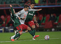 MOSCOW, RUSSIA - OCTOBER 27: Robert Lewandowski of FC Bayern Muenchen is tackled by Daniil Kulikov [left] & Murilo Cerqueira [right] of Lokomotiv Moskva during the UEFA Champions League Group A stage match between Lokomotiv Moskva and FC Bayern Muenchen at RZD Arena on October 27, 2020 in Moscow, Russia. (Photo by MB Media)