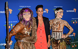 Dame Kelly Holmes (centre) and cast members attending the premiere of Cirque du Soleil's Totem, in support of the Sentebale charity, held at the Royal Albert Hall, London.