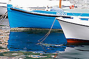 a blue and a white boat in the old Marina harbour Dubrovnik, old city. Dalmatian Coast, Croatia, Europe.