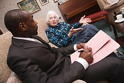 Professional with elderly woman.