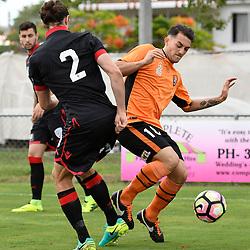 BRISBANE, AUSTRALIA - DECEMBER 10: Michael Marrone of Adelaide United is tackled by Nicholas Panetta of the Roar during the round 5 Foxtel National Youth League match between the Brisbane Roar and Adelaide United at AJ Kelly Field on December 10, 2016 in Brisbane, Australia. (Photo by Patrick Kearney/Brisbane Roar)