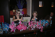 Jo Wilmot and Kristen Lovelock, ( glasses)  Fo(u)r Party hosted by Nicolas Feullatte champage at Mivida, 8-9 Argyll Street. London.   October 11 2005. ONE TIME USE ONLY - DO NOT ARCHIVE © Copyright Photograph by Dafydd Jones 66 Stockwell Park Rd. London SW9 0DA Tel 020 7733 0108 www.dafjones.com