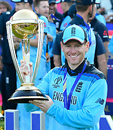 Eoin Morgan of England holds the Cricket World Cup aloft as he celebrates his team becoming World Champions during the ICC Cricket World Cup 2019 Final match between New Zealand and England at Lord's Cricket Ground, St John's Wood, United Kingdom on 14 July 2019.