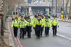 Scotland Yard, London, March 23rd 2017. Police march towards the scene of the ongoing investigation in the aftermath of Tuesday's terrorist attack on Westminster Bridge and in the grounds of Parliament, in which four people and their attacker were killed with over 40 injured.