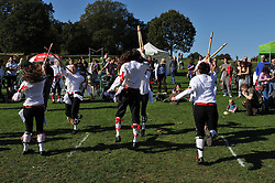 © Copyright licensed to London News Pictures. 06/10/2010. Women Morris dancers entertain the crowds on an unseasonably warm day at Parliament Hill, Hamsptead Heath, London. The Annual Heath Heritage Festival hosts the annual Hampstead Heath Conker Competition. Representatives of the RSPB, National Trust, volunteer group Heath Hands, local beekeepers and woodworkers were in attendance.