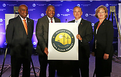 June 26, 2017 - USA - Derrick Henry of Daytona Beach, Fla., Steve Benjamin of Columbia, S.C., Rick Kriseman, of St. Petersburg, Fla., and Elise Partin, of Cayce, S.C., hold a sign showing their support for 100% clean energy following a press conference on Monday afternoon, June 26, 2017 in Miami Beach, held to highlight the growing support from mayors across the country for the goal of moving to 100% clean, renewable energy. (Credit Image: © Emily Michot/TNS via ZUMA Wire)