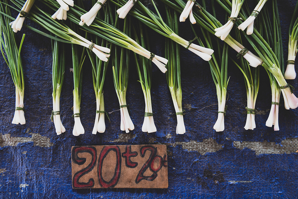 Scallions (green onions) displayed for sale in 20-toea bundles at the market in Wewak, Papua New Guinea.<br /><br />(July 21, 2017)