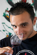 François Giraud, son of Pierre, who runs the property with his sister Marie Domaine Giraud, Chateauneuf-du-Pape. Rhone. Owner winemaker. Tasting wine. France Europe. Wine glass.