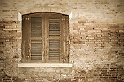 Wooden shutters and brick wall, Burano, Veneto, Italy
