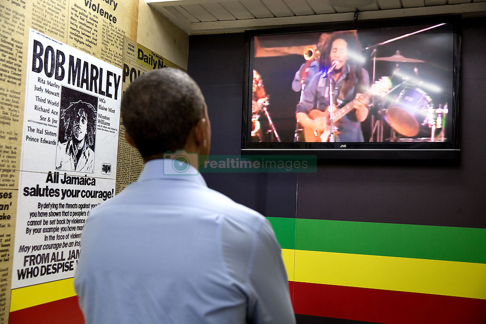 President Barack Obama watches a video of Bob Marley during a visit to the Bob Marley Museum in Kingston, Jamaica, April 8, 2015. (Official White House Photo by Pete Souza)<br /> <br /> This official White House photograph is being made available only for publication by news organizations and/or for personal use printing by the subject(s) of the photograph. The photograph may not be manipulated in any way and may not be used in commercial or political materials, advertisements, emails, products, promotions that in any way suggests approval or endorsement of the President, the First Family, or the White House.