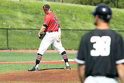 17 April 2016:  David Meade checks the runner at 1st base during an NCAA Division I Baseball game between the Southern Illinois Salukis and the Illinois State Redbirds in Duffy Bass Field, Normal IL