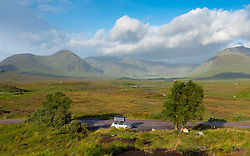 View  of Rannoch Moor in summer with car with roof tent on A82, Scotland, UK