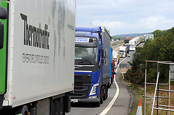 © Licensed to London News Pictures. 28/07/2015<br /> Lorries queuing on the Junction 8 Slip road for Leeds,Kent.<br /> <br /> Operation stack is back on the M20 in Kent.<br /> Just days after Operation Stack was taken off the M20, it was brought back in the early hours of this morning.<br /> The authorities are blaming a heavy volume of traffic heading towards the Port of Dover and Eurotunnel and the continued disruption in Calais.<br /> The coast-bound carriageway between junctions 8 and 9 is closed to allow lorries to park, but the slip roads at junctions 9, 10 and 12 and 13 have also been shut. <br /> <br /> (Byline:Grant Falvey/LNP)