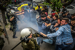 April 16, 2018 - Athens, Greece - Supporters of the Greek Communist party try to pull down a statue of U.S. President Harry S. Truman during a protests against U.S.-led airstrikes in Syria. Police used tear gas to disperse the protesters and the statue was not damaged. (Credit Image: © Eurokinissi via ZUMA Wire)