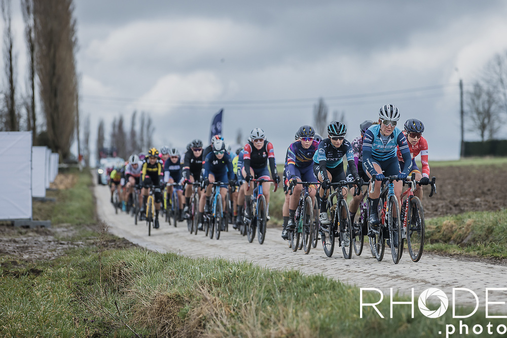 peloton riding a cobbled section<br /> <br /> 2nd Nokere Koerse WE (BEL) 2021<br /> UCI Women Elite 1.PRO<br /> One Day Race: Deinze > Nokere 124km