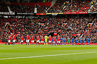 Football - 2021 / 2022 Pre-Season Friendly - Manchester United vs Everton - Old Trafford - Saturday 7th August 2021<br /> <br /> The two teams stand before the game to lead a minutes support for NHS workers, at Old Trafford.<br /> <br /> COLORSPORT/ALAN MARTIN