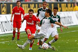 24.04.2010, Volkswagen Arena, Wolfsburg, GER, 1.FBL, VfL Wolfsburg vs 1.FC Koeln, im Bild Mato Jajalo (Koeln #19) kann den Ball vor Diego (Wolfsburg #28) spielen .EXPA Pictures © 2011, PhotoCredit: EXPA/ nph/  Schrader       ****** out of GER / SWE / CRO  / BEL ******