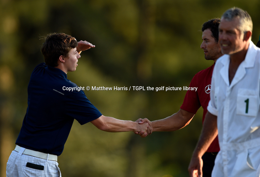 Matthew FITZPATRICK (ENG) shakes hands with Adam SCOTT (AUS) at 18th during second round US Masters 2014,Augusta National,Augusta, Georgia,USA.