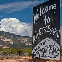 A road sign welcomes visitors to the town of Navajo Mountain, Utah.