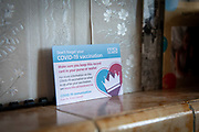 A patient record card to say they have received their COVID-19 vaccination sits on the mantle piece after being given out by Dr Fordham of the Channel Health Alliance after administering the COVID-19 vaccination to a patient at their home in the community outside Dover on the 27th of February 2021, Dover, Kent, United Kingdom.