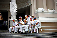 A brass band gathers before a Sunday morning concert in front of the Opera House in Ho Chi Minh City, Vietnam, Southeast Asia September 2011.